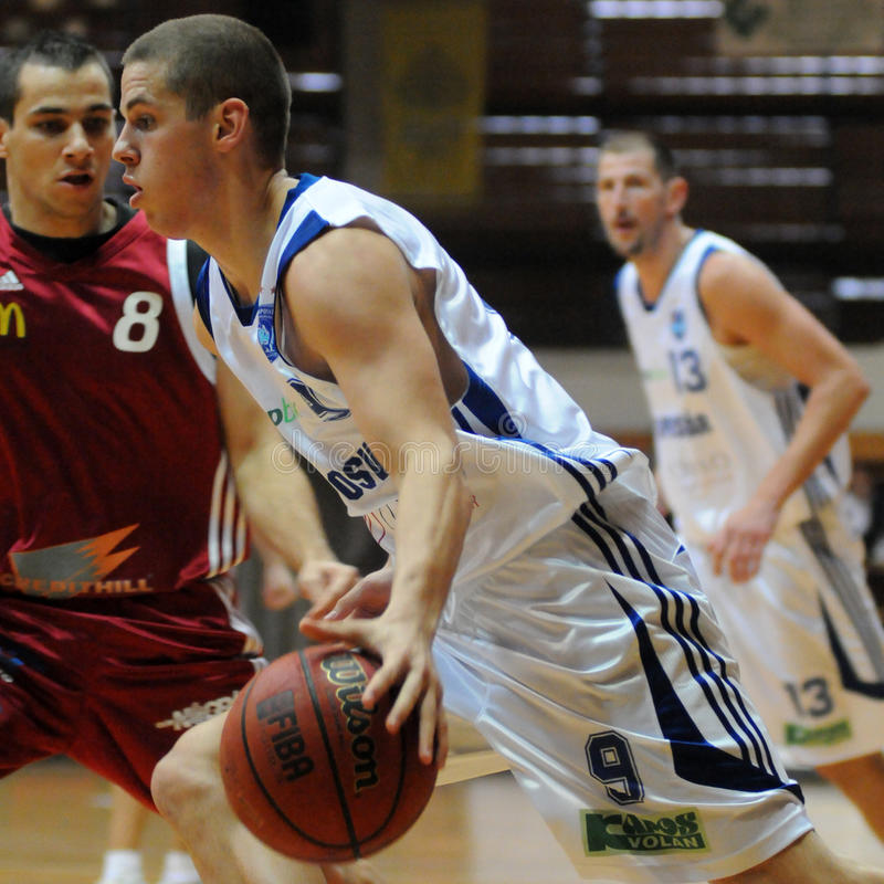 Kaposvar - Salgotarjan basketball game. KAPOSVAR, HUNGARY - OCTOBER 10: David Vojvoda (9) in action at Hungarian National Championship basketball game Kaposvar royalty free stock photography
