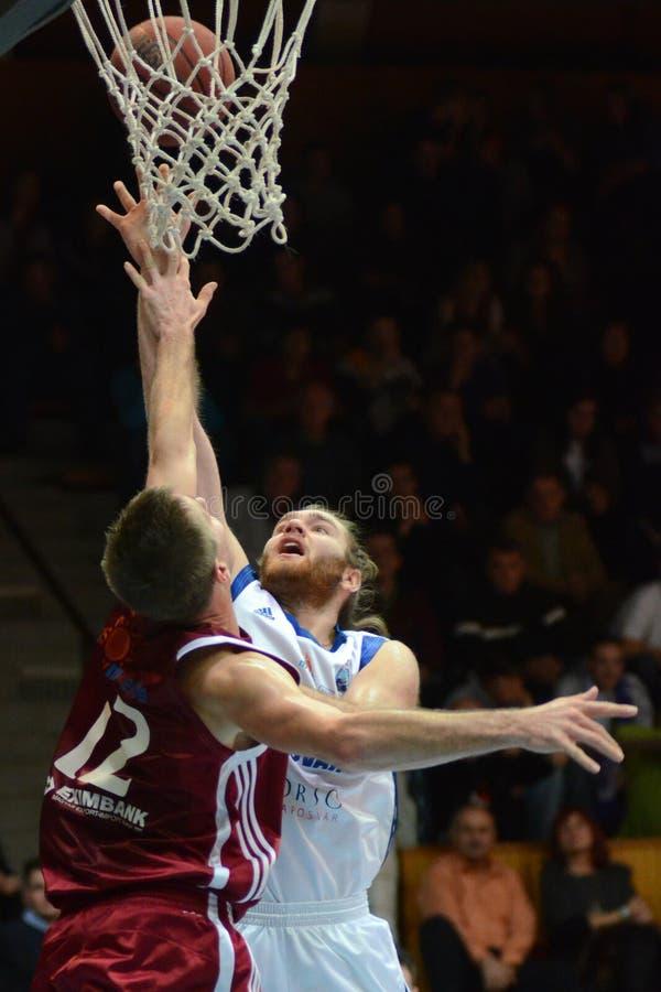 Kaposvar - Salgotarjan basketball game. KAPOSVAR, HUNGARY - DECEMBER 11: Kurt Cunningham (in white) in action at a Hungarian Championship basketball game royalty free stock photo