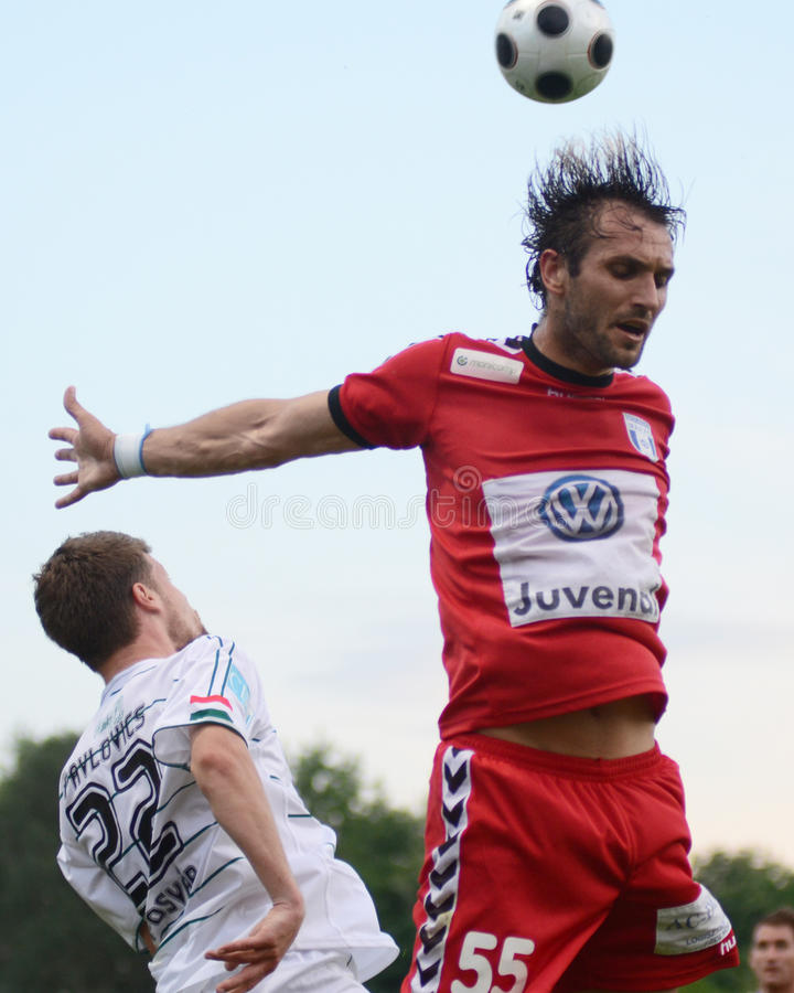 Kaposvar - Szolnok soccer game. KAPOSVAR, HUNGARY - MAY 14: Gosic Dragan (in red) in action at a Hungarian National Championship soccer game - Kaposvar vs stock image