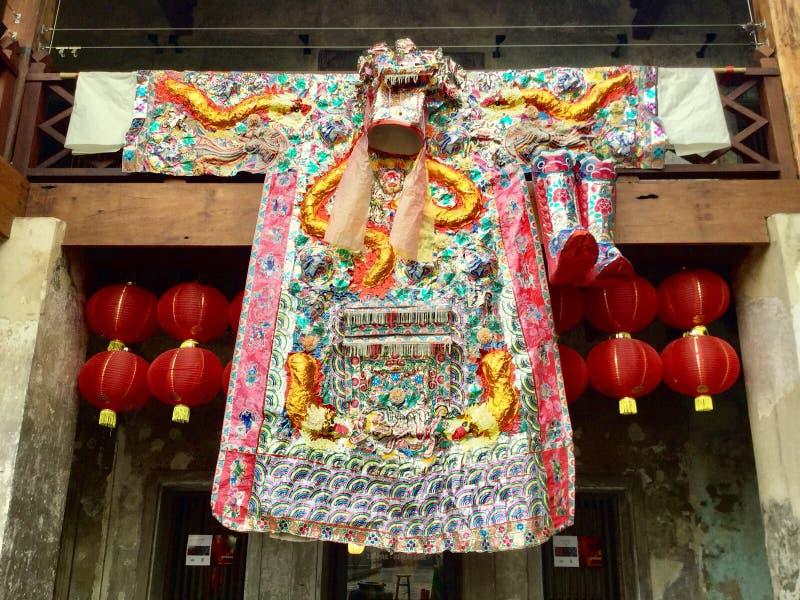 Kappa för kinesisk stil garnering färgrikt dräkt arkivfoton