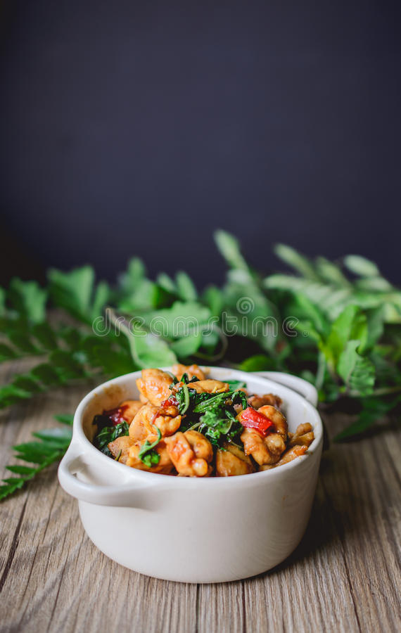 Kapro Gai, Stir Fried Basil Cicken on wooden, Thai Famous Food, Thai Street. Stir Fried Basil Cicken on wooden, Thai Famous Food, Thai Street Food, Thai Cuisine stock photos