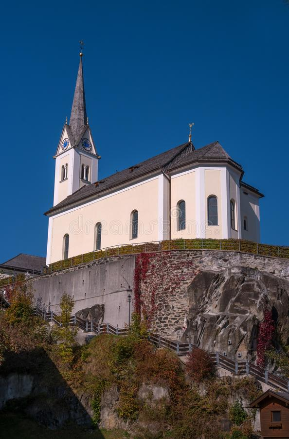 Kaprun, Austria. Catholic church St. Margaretha. Church on the mountain. Steep stairs lead to the church stock images