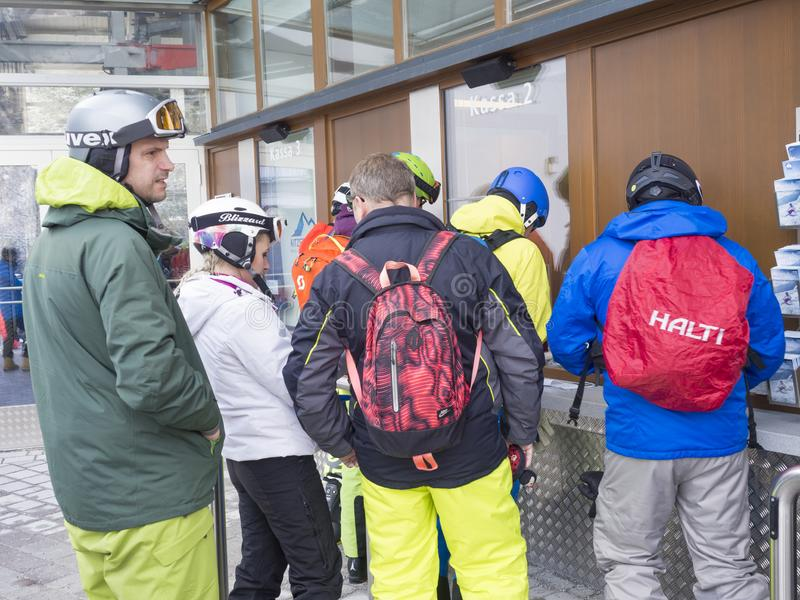 KAPRUN, AUSTRIA, March 12, 2019: People skiers buyingtheir ski pass at tickets office at Kitzsteinhorn ski resort on royalty free stock images