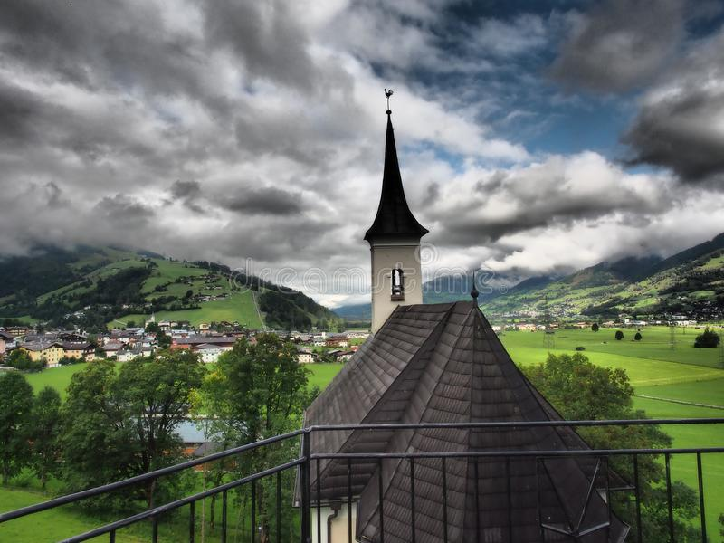Church and clouds in the background.The Old Castle of Kaprun is almost the skeleton of the former Burg. Kaprun is a municipality in the Zell am See District in royalty free stock image