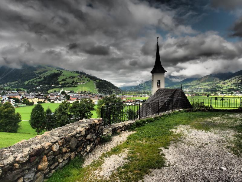 Church and clouds in the background.The Old Castle of Kaprun is almost the skeleton of the former Burg. Kaprun is a municipality in the Zell am See District in stock photo
