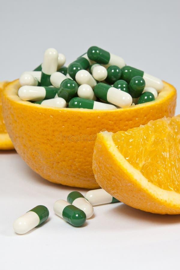 kapsuły pomarańcze zdjęcie royalty free