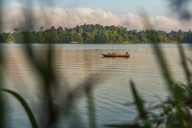 Journey by boat in the tranquil Morning  in Kaptai Lake in Bangladesh royalty free stock photos