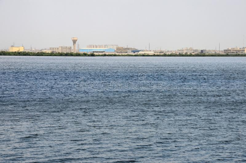 View across the Creek Marina water in Karachi Pakistan. Karachi, Pakistan - September 10, 2016: A view of a part of south Karachi overlooking the city`s creek royalty free stock image