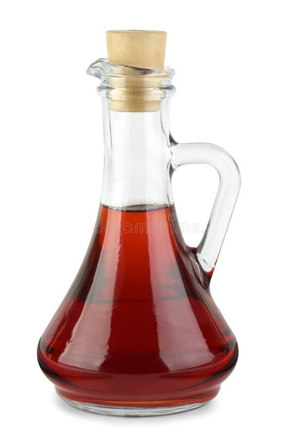 Karaf met rode wijnazijn stock afbeelding