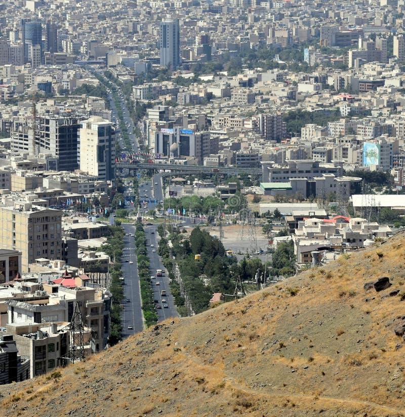 Karaj Iranian city urban skyline aerial view from mountains royalty free stock photo