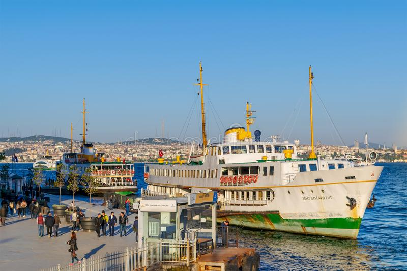 Karakoy ferry terminal before sunset with passengers departing and entering the terminal, Istanbul, Turkey royalty free stock photos