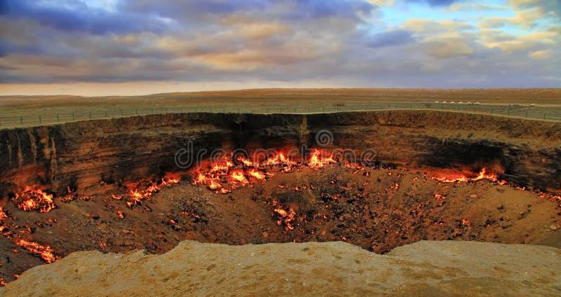 The Karakum Desert. Turkmenistan. Darvaza. Burning gas crater called Gates of Hell. royalty free stock photo