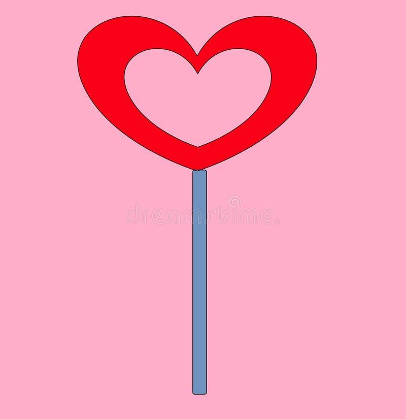 Karamellgodis på en pinne i formen av en hjärta royaltyfri foto