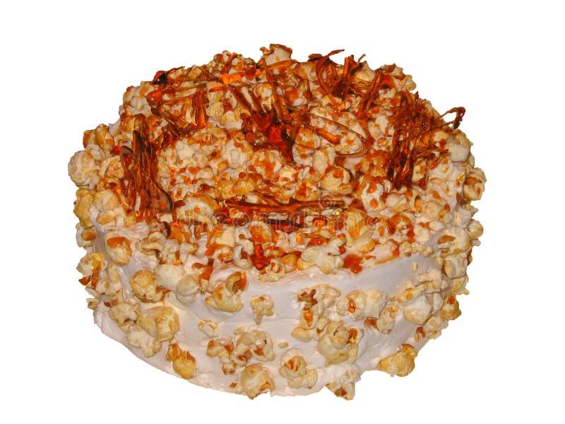 Karamellkaka med karamellsås och karamellpopcorn royaltyfri foto