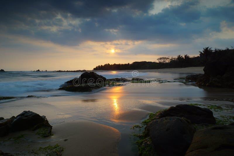 Karang Songsong beach, Banten Indonesia. Sunset in Karangsongsong beach in Banten royalty free stock images