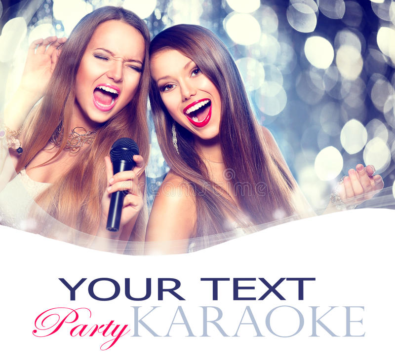 Karaoke. Beauty girls with a microphone royalty free stock image