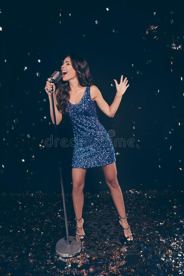 Karaoke contest. Vertical full length body size of diva star on. Scene cheerful slim graceful charming attractive exquisite wavy-haired lady high heels shoes stock photos