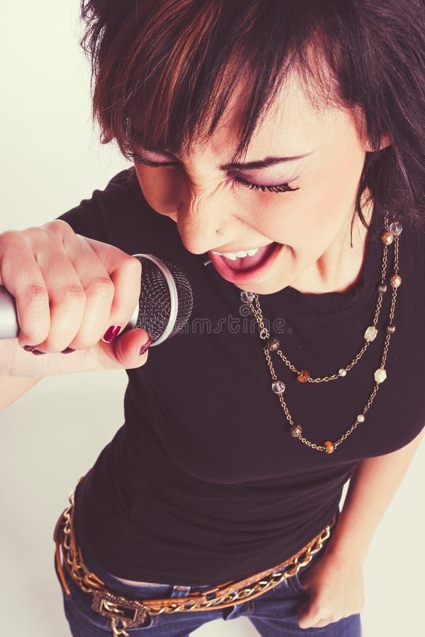 Karaoke do canto da menina foto de stock royalty free