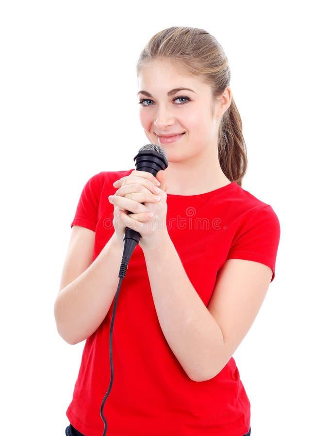 Karaoke do canto da menina fotografia de stock
