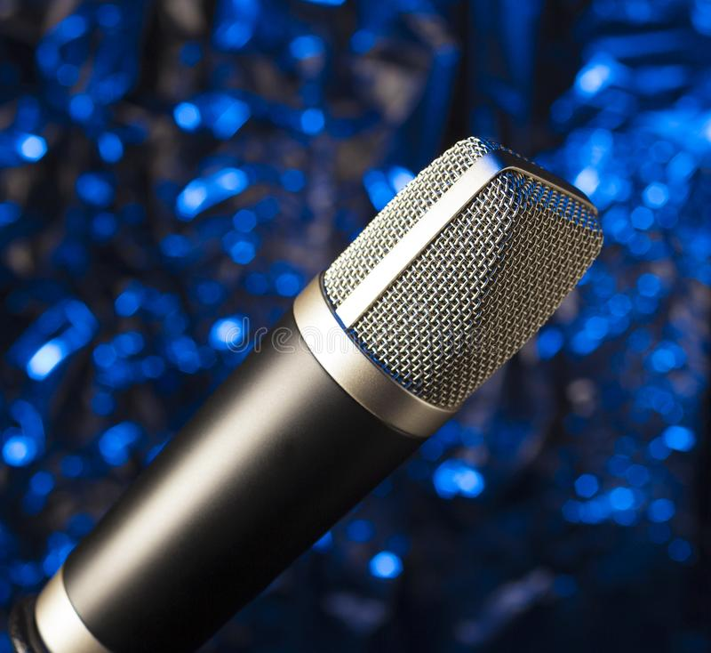 Karaoke microphone on a blue background stock photo