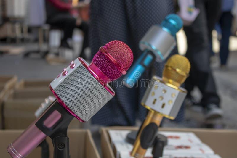 Karaoke microphone with feet. It has a loudspeaker on it. It was taken in front of the store stock photo