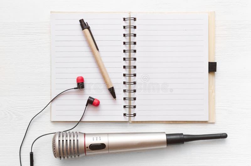Karaoke singer. Microphone. Sound recording studio background. Song lyrics copy space. Audio recording studio desk table. Karaoke mock up. Microphone stock image