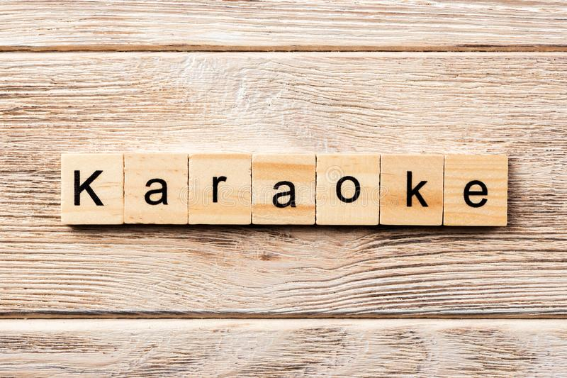 Karaoke word written on wood block. karaoke text on table, concept.  royalty free stock photos
