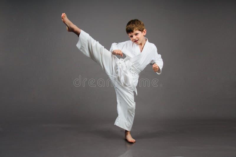 Karate boy in white kimono stock photography