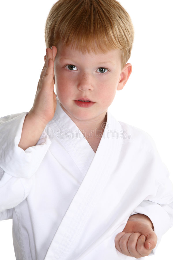 Karate chop. American boy making karate chop over white background. Clipping path stock photography