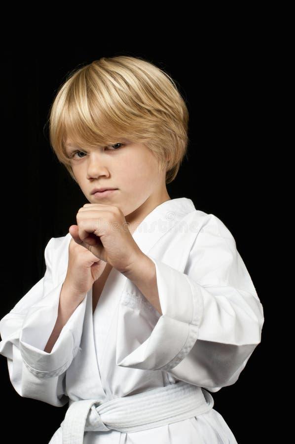 Karate dzieciaka szkolenie zdjęcie stock