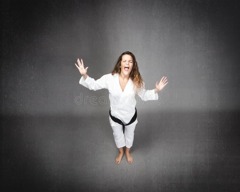 Karate dziewczyny krzyczeć obrazy stock