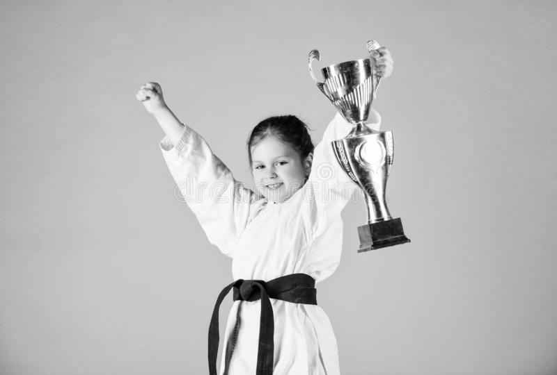Karate fighter child. Karate sport concept. Self defence skills. Karate gives feeling of confidence. Strong and. Confident small kid. Victory and win. Girl royalty free stock images