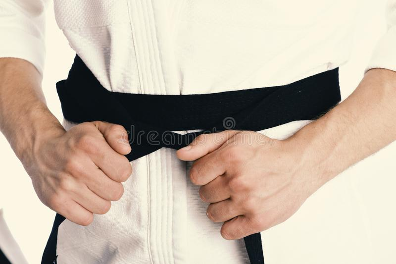 Karate fighter with fit strong hands gets ready to fight. Japanese karate and sports concept. Male torso and sportive stock photo
