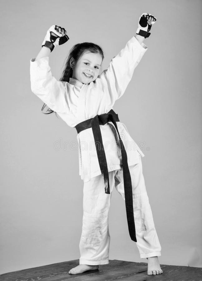 Karate fighter ready to fight. Karate sport concept. Self defence skills. Karate gives feeling of confidence. Strong and. Confident kid. She is dangerous. Girl royalty free stock images