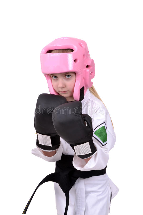 Karate Gear. Little girl wearing karate sparring gear isolated white background stock photo