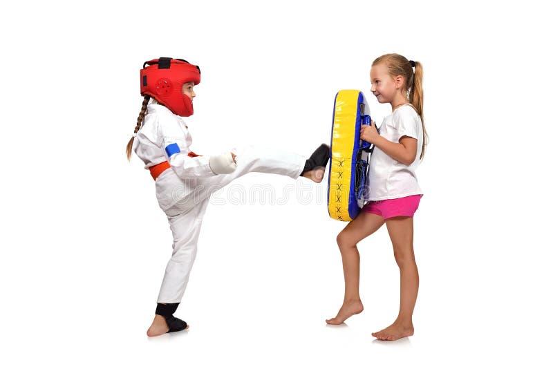 Karate girl It fulfills kicks. On a white background stock photo