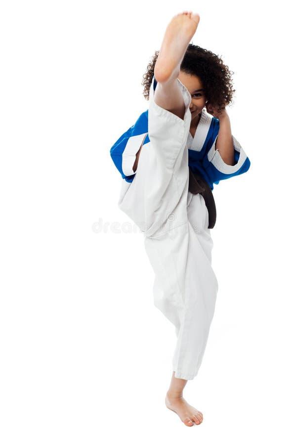 Karate girl kick a leg royalty free stock image