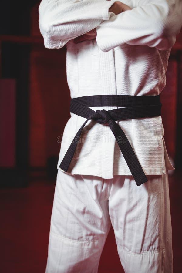 Karate gracz w czarnym pasku obrazy royalty free