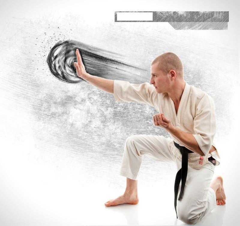 karate Hombre en un kimono en el blanco fotos de archivo libres de regalías