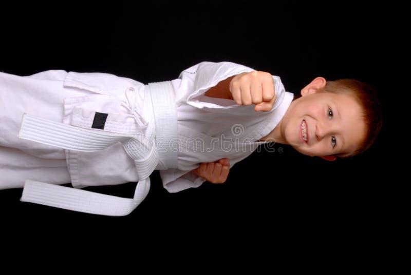 Karate Kid (foco no punho) imagens de stock
