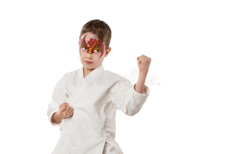 Karate kid with red gragon face painting royalty free stock photography