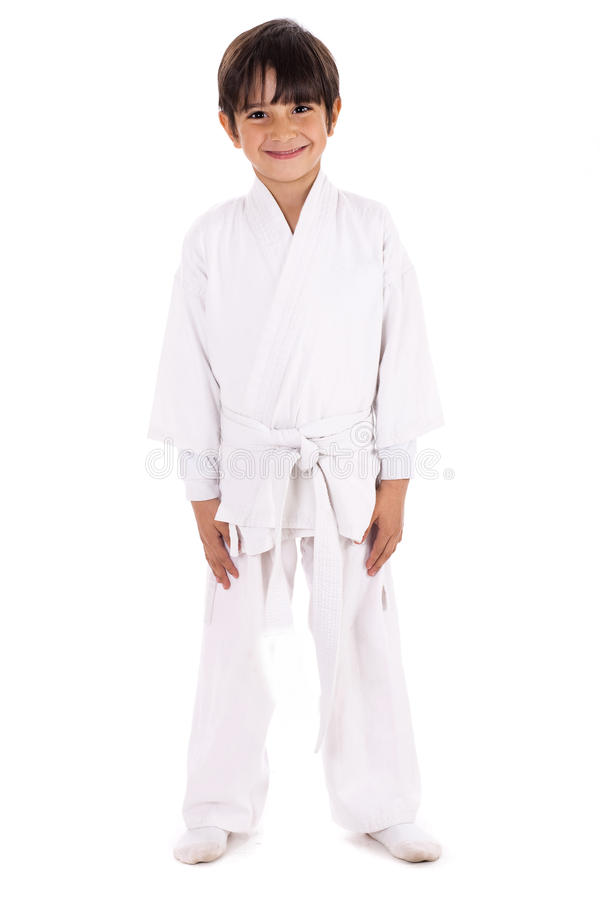 Karate kid in uniform. On white isolated background stock photos
