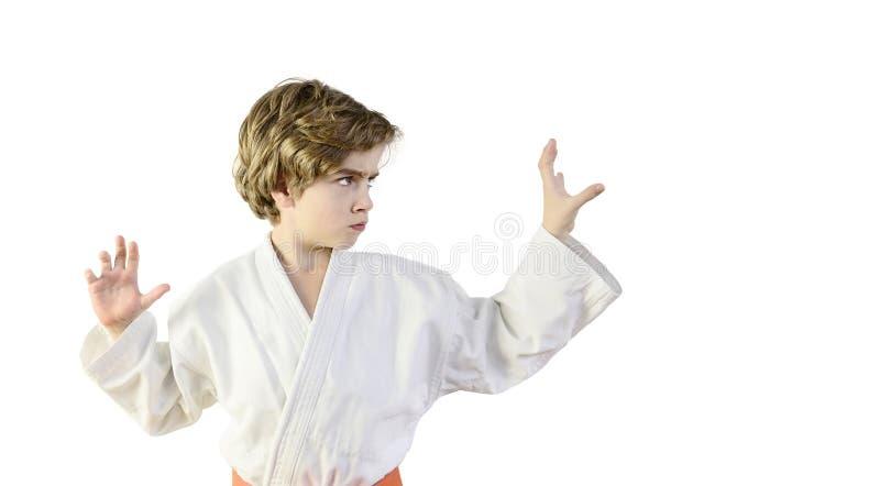 Karate kid in a white kimono royalty free stock image
