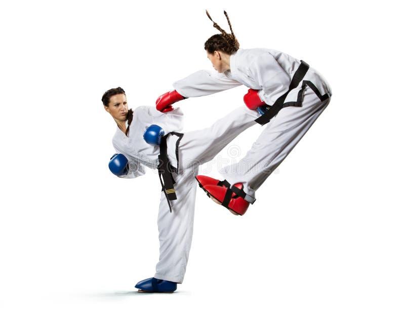 Karate kobieta w akci odizolowywającej w bielu obraz royalty free