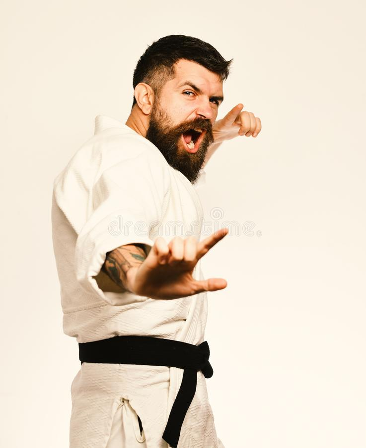 Karate man with angry face in uniform. Oriental sports concept. stock photography