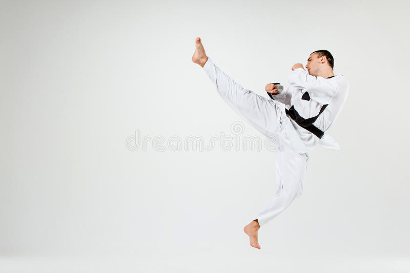 The karate man with black belt stock images