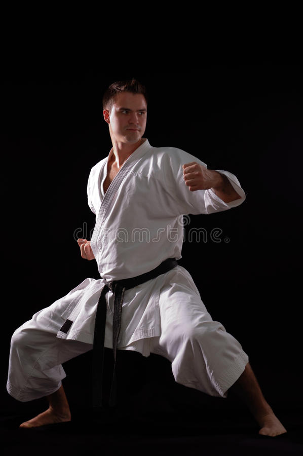 Karate man champion of the world. On black background studio shot royalty free stock photography