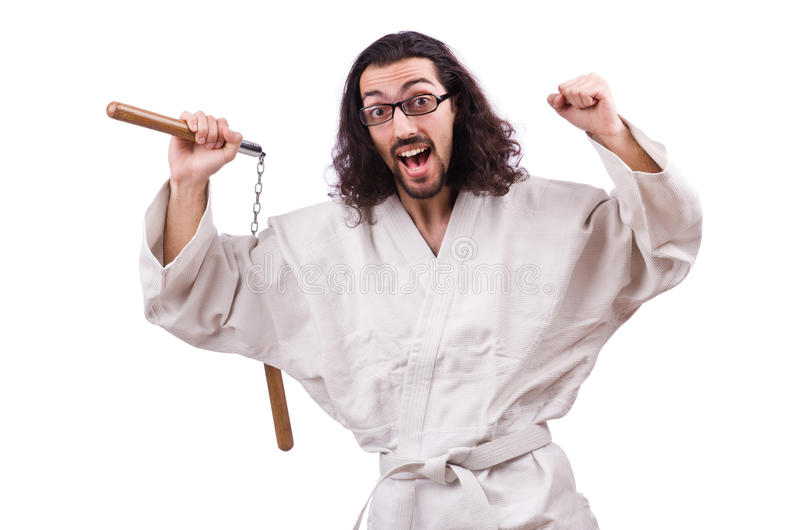 Karate man with nunchucks isolated. On white royalty free stock images