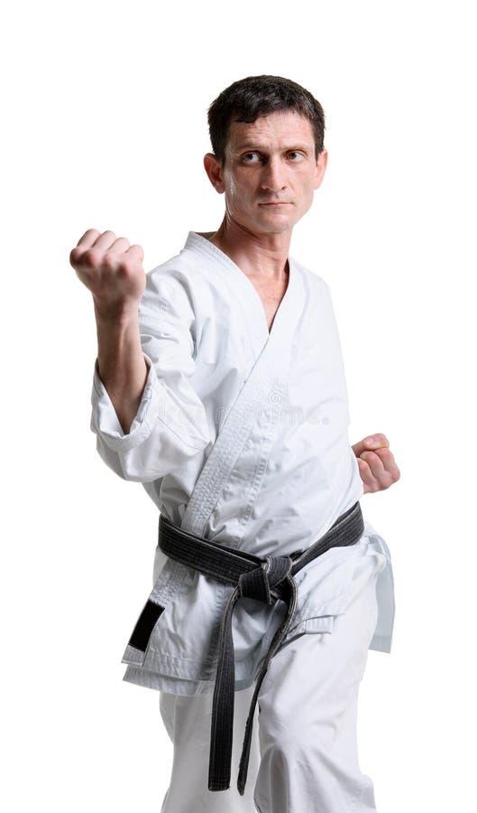 Karate. Mens in een kimono stock foto