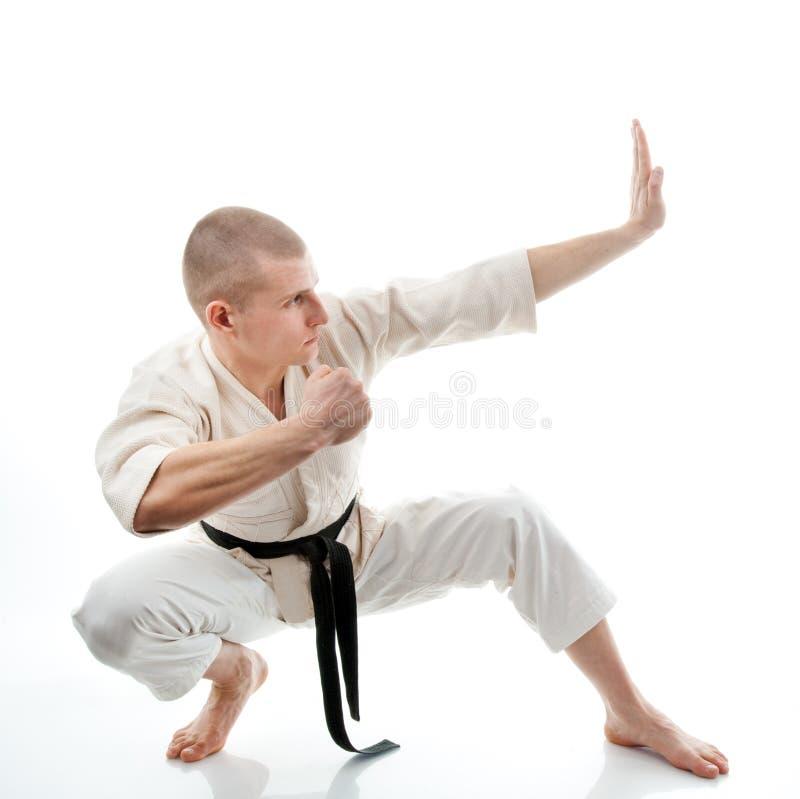 karate Mens in een kimono stock afbeelding